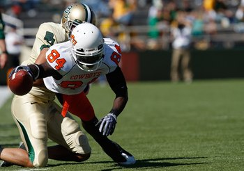 WACO, TX - OCTOBER 24:  Hubert Anyiam #84 of the Oklahoma State Cowboys runs the ball against the Baylor Bears at Floyd Casey Stadium on October 24, 2009 in Waco, Texas.  (Photo by Ronald Martinez/Getty Images)