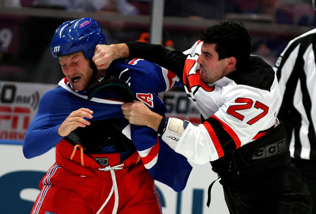 NEW YORK, NY - OCTOBER 22:  Sean Avery #16 of the New York Rangers fights with Mike Mottau #27 of the New Jersey Devils during their game on October 22, 2009 at Madison Square Garden in New York City, New York.  (Photo by Al Bello/Getty Images)