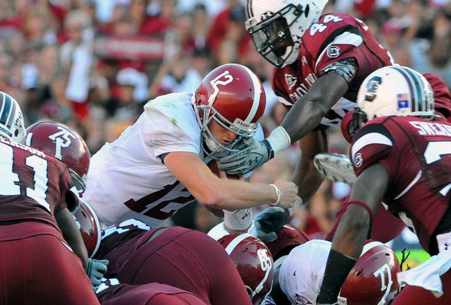 COLUMBIA, SC - OCTOBER 9: Quarterback Greg McElroy of the Alabama Crimson Tide dives for a short gain and a first down at midfield against the South Carolina Gamecocks October 9, 2010 at Williams-Brice Stadium in Columbia, South Carolina.  (Photo by Al Me