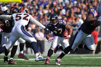 BALTIMORE, MD - OCTOBER 10:  Ray Rice #27 of the Baltimore Ravens runs the ball against the Denver Broncos at M&T Bank Stadium on October 10, 2010 in Baltimore, Maryland. Players wore pink in recognition of Breast Cancer Awareness Month. The Ravens defeat