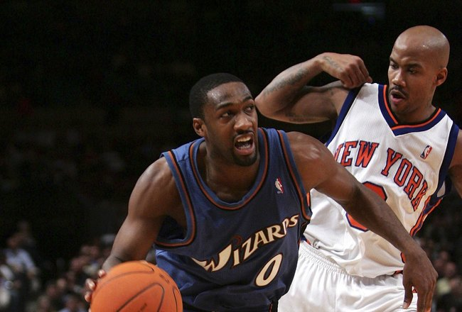 NEW YORK - DECEMBER 06:  Gilbert Arenas #0 of the Washington Wizards drives past Stephon Marbury #3 of the New York Knicks on December 06, 2006 at Madison Square Garden in New York City. NOTE TO USER: User expressly acknowledges and agrees that, by downlo