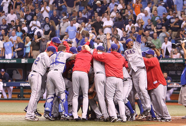 ST. PETERSBURG, FL - OCTOBER 12:  The Texas Rangers celebrate after winning Game 5 of the ALDS against the Tampa Bay Rays at Tropicana Field on October 12, 2010 in St. Petersburg, Florida.  (Photo by Mike Ehrmann/Getty Images)