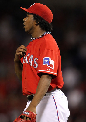 ARLINGTON, TX - OCTOBER 09:  Pitcher Neftali Feliz #30 of the Texas Rangers reacts after giving up a homerun to Carl Crawford #13 of the Tampa Bay Rays in the 9th inning during game 3 of the ALDS at Rangers Ballpark in Arlington on October 9, 2010 in Arli