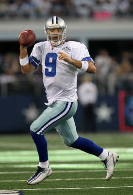 ARLINGTON, TX - OCTOBER 10:  Quarterback Tony Romo #9 of the Dallas Cowboys scrambles with the ball against the Tennessee Titans at Cowboys Stadium on October 10, 2010 in Arlington, Texas. The Titans won 34-27.  (Photo by Stephen Dunn/Getty Images)