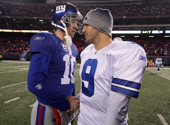 EAST RUTHERFORD, NJ - DECEMBER 06: Eli Manning #10 of the New York Giants is congratulated by Tony Romo #9 of the Dallas Cowboys after the Giants won 31-24 at Giants Stadium on December 6, 2009 in East Rutherford, New Jersey. (Photo by Jim McIsaac/Getty I