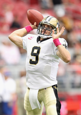 GLENDALE, AZ - OCTOBER 10:  Quarterback Drew Brees #9 of the New Orleans Saints warms up before the NFL game against the Arizona Cardinals at the University of Phoenix Stadium on October 10, 2010 in Glendale, Arizona. The Cardinals defeated the Saints 30-