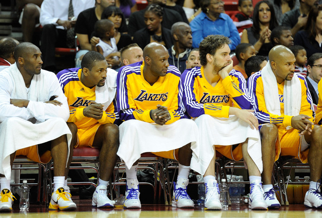 LAS VEGAS - OCTOBER 13:  (L-R) Kobe Bryant #24, Ron Artest #15, Lamar Odom #7, Pau Gasol #16 and Derek Fisher #2 of the Los Angeles Lakers watch from the bench during a preseason game against the Sacramento Kings at the Thomas & Mack Center October 13, 20