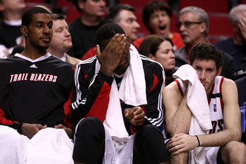 PORTLAND, OR - APRIL 18:  LaMarcus Aldridge (L) #12, Greg Oden (C) #52 and Rudy Fernandez (R) #5 of the Portland Trail Blazers watch the game from the bench against the Houston Rockets during Game 1 of the Western Conference Quarterfinals of the NBA Playo