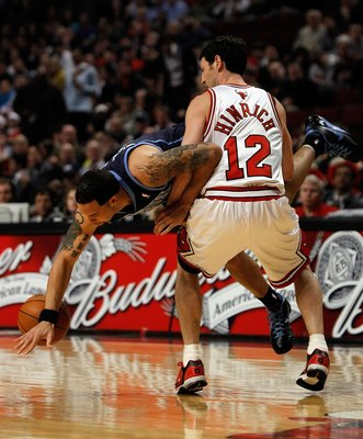 CHICAGO - MARCH 09: Deron Williams #8 of the Utah Jazz flips in the air and looses the ball as he is fouled by Kirk Hinrich #12 of the Chicago Bulls at the United Center on March 9, 2010 in Chicago, Illinois. The Jazz defeated the Bulls 132-108. NOTE TO U