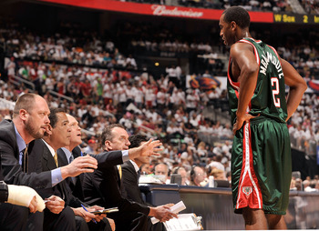 ATLANTA - APRIL 17:  Luc Richard Mbah a Moute #12 of the Milwaukee Bucks confers with the coaching staff during a 102-92 loss to the Atlanta Hawks during Game One of the Eastern Conference Quarterfinals of the 2010 NBA Playoffs at Philips Arena on April 1