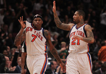 NEW YORK - JANUARY 28:  Al Harrington #7 of the New York Knicks celebrates a basket with teammate Wilson Chandler #21 against the Toronto Raptors at Madison Square Garden on January 28, 2010 in New York, New York. NOTE TO USER: User expressly acknowledges