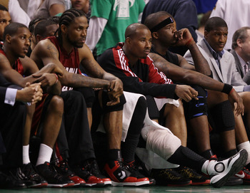 BOSTON - APRIL 20:  Mario Chalmers #6, Udonis Haslem #40,Quentin Richardson #5 and Jermaine O'Neal #7 of the Miami Heat sit on the bench in the fourth quarter against the Boston Celtics during Game Two of the Eastern Conference Quarterfinals of the 2010 N