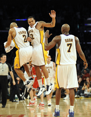 LOS ANGELES, CA - JANUARY 10:  Shannon Brown #12 of the Los Angeles Lakers celebrates his last second three pointer to end the third quarter with Derek Fisher #2 and Lamar Odum #7 against the Milwaukee Bucks at Staples Center on January 10, 2010 in Los An