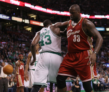 BOSTON - MAY 13:  Kendrick Perkins #43 of the Boston Celtics and Shaquille O'Neal #33 of the Cleveland Cavaliers fight for the ball during Game Six of the Eastern Conference Semifinals of the 2010 NBA playoffs at TD Garden on May 13, 2010 in Boston, Massa