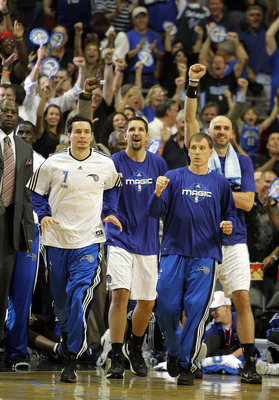 ORLANDO, FL - MAY 06:  J.J. Redick #7, Ryan Anderson #33, Jason Williams #44 and Marcin Gortat #13 of the Orlando Magic celebrate after Jameer Nelson #14 hits a desperation three-point basket with less than a second left in the third quarter to give the M