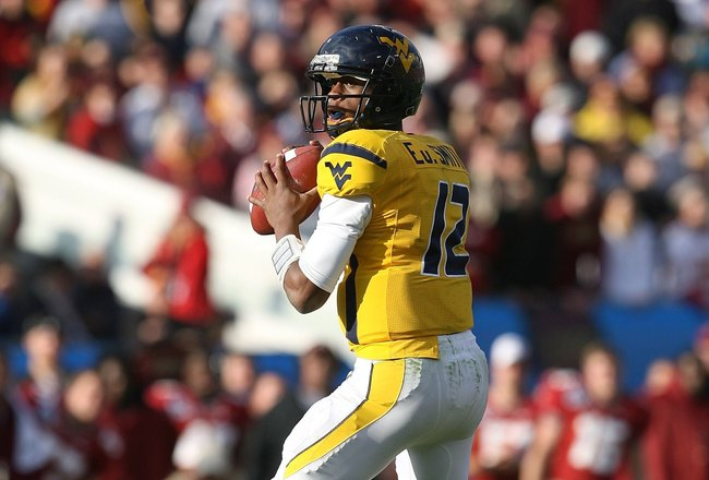 JACKSONVILLE, FL - JANUARY 01:  Quarterback Geno Smith #12 of the West Virginia Mountaineers drops back to pass against the Florida State Seminoles during the Konica Minolta Gator Bowl on January 1, 2010 at Jacksonville Municipal Stadium in Jacksonville,
