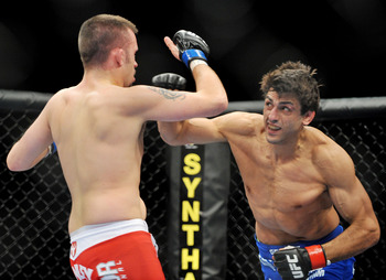 LAS VEGAS - NOVEMBER 21: Jason Dent (L) battles George Sotiropoulos (R) during their Lightweight Fight at the UFC 106 at Mandalay Bay Events Center on November 21, 2009 in Las Vegas, Nevada. (Photo by Jon Kopaloff/Getty Images)