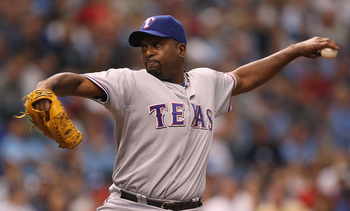 ST PETERSBURG, FL - OCTOBER 07:  Darren Oliver #28 of the Texas Rangers pitches during Game 2 of the ALDS against the Tampa Bay Rays at Tropicana Field on October 7, 2010 in St. Petersburg, Florida.  (Photo by Mike Ehrmann/Getty Images)