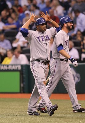 ST. PETERSBURG, FL - OCTOBER 12:  Nelson Cruz #17 of the Texas Rangers gives the deer horns after scoring on a throwing error by catcher Kelly Shoppach during Game 5 of the ALDS at Tropicana Field on October 12, 2010 in St. Petersburg, Florida.  (Photo by