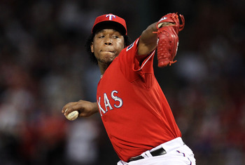 ARLINGTON, TX - OCTOBER 09:  Pitcher Neftali Feliz #30 of the Texas Rangers throws against the Tampa Bay Rays in the 9th inning during game 3 of the ALDS at Rangers Ballpark in Arlington on October 9, 2010 in Arlington, Texas.  (Photo by Ronald Martinez/G