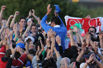 NEWPORT, WALES - OCTOBER 04:  Edoardo Molinari of Europe celebrates his team's victory with supporters at the end of the singles matches during the 2010 Ryder Cup at the Celtic Manor Resort on October 4, 2010 in Newport, Wales.  (Photo by Andy Lyons/Getty
