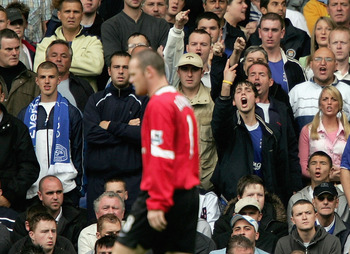 LIVERPOOL, ENGLAND -  AUGUST 13 : Wayne Rooney  of Man United is acknowledged by the Everton fans during the Barclays Premiership match between Everton and Manchester United at Goodison Park on August 13, 2005 in Liverpool, England.  (Photo by Clive Bruns
