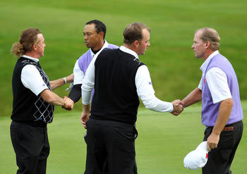 NEWPORT, WALES - OCTOBER 02:  Tiger Woods and Steve Stricker (R) of the USA shake hands with Peter Hanson and Miguel Angel Jimenez (L) after winning their match on the 15th green during the rescheduled Afternoon Foursome Matches during the 2010 Ryder Cup