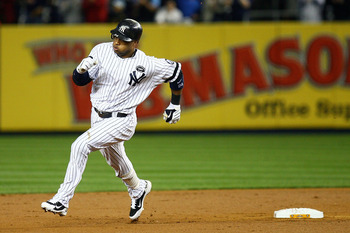 NEW YORK - OCTOBER 09:  Robinson Cano #24 of the New York Yankees rounds second base on his triple in the bottom of the second inning against the Minnesota Twins during Game Three of the ALDS part of the 2010 MLB Playoffs at Yankee Stadium on October 9, 2