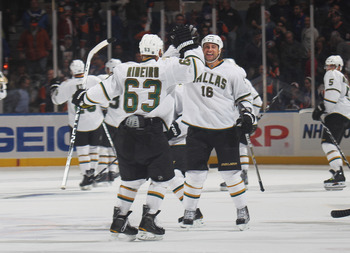 UNIONDALE, NY - OCTOBER 09: Mike Ribeiro #63 of the Dallas Stars scores in the shootout and is greeted by Adam Burish #16 in their game against the New York Islanders at the Nassau Coliseum on October 9, 2010 in Uniondale, New York. The Stars defeated the