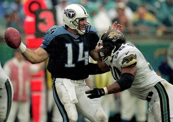 26 Sep 1999:  Neil O''Donnell #14 of the Tennessee Titans is sacked during a game against the Jacksonville Jaguars at the Alltel Stadium in Jacksonville, Florida. The Titans defeated the Jaguars 20-19. Mandatory Credit: Tom Hauck  /Allsport