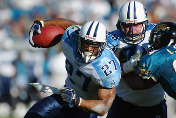 JACKSONVILLE, FL - DECEMBER 22:  Running back Eddie George #27 of the Tennessee Titans runs against the Jacksonville Jaguars during the game at Alltel Stadium on December 22, 2002 in Jacksonville, Florida. The Titans defeated the Jaguars 26-10. (Photo By