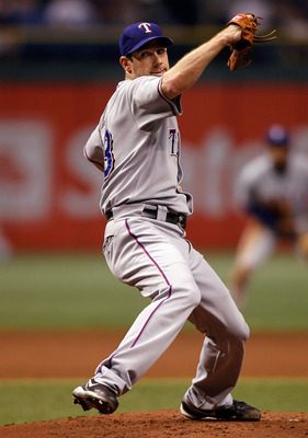 ST. PETERSBURG, FL - OCTOBER 12:  Pitcher Cliff Lee #33 of the Texas Rangers pitches against the Tampa Bay Rays during Game 5 of the ALDS at Tropicana Field on October 12, 2010 in St. Petersburg, Florida.  (Photo by J. Meric/Getty Images)
