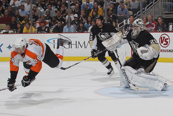 PITTSBURGH - OCTOBER 07: Marc-Andre Fleury #29 of the Pittsburgh Penguins trips up Claude Giroux #28 of the Philadelphia Flyers at the Consol Energy Center on October 7, 2010 in Pittsburgh, Pennsylvania.  (Photo by Bruce Bennett/Getty Images)