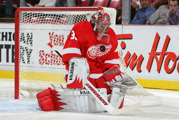 DETROIT - OCTOBER 8:  Jimmy Howard #35 of the Detroit Red Wings makes a save against the Anaheim Ducks during their NHL game at Joe Louis Arena on October 8, 2010 in Detroit, Michigan.(Photo By Dave Sandford/Getty Images)