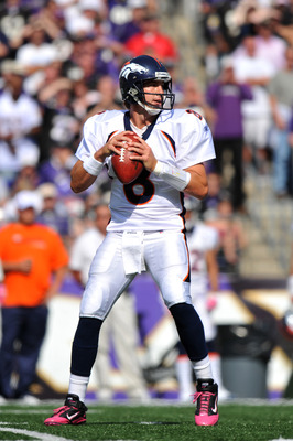 BALTIMORE, MD - OCTOBER 10: Kyle Orton #8 of the Denver Broncos passes against the Baltimore Ravens at M&T Bank Stadium on October 10, 2010 in Baltimore, Maryland. Players wore pink in recognition of Breast Cancer Awareness Month. The Ravens defeated the