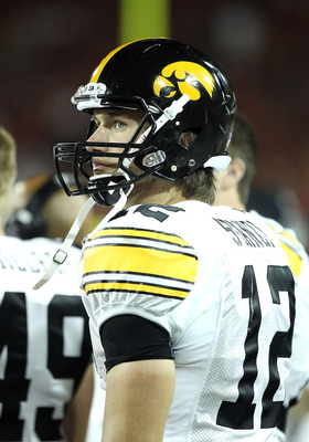 TUCSON, AZ - SEPTEMBER 18:  Quarterback Ricky Stanzi #12 of the Iowa Hawkeyes watches from the sidelines during the college football game against the Arizona Wildcats at Arizona Stadium on September 18, 2010 in Tucson, Arizona.  The Wildcats defeated the