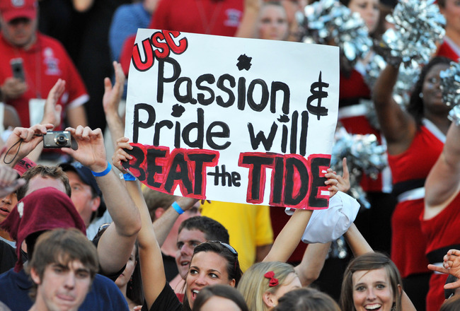 COLUMBIA, SC - OCTOBER 9: Fans of the South Carolina Gamecocks cheer a victory against the Alabama Crimson Tide October 9, 2010 at Williams-Brice Stadium in Columbia, South Carolina.  (Photo by Al Messerschmidt/Getty Images)