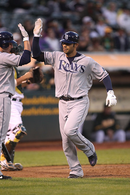 OAKLAND, CA - AUGUST 19:  Carlos Pena #23 of the Tampa Bay Rays celebrates after hitting a two run home run against the Oakland Athletics in the fourth inning during an MLB game at the Oakland-Alameda County Coliseum on August 19, 2010 in Oakland, Califor