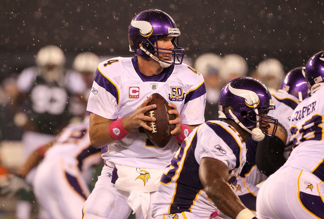EAST RUTHERFORD, NJ - OCTOBER 11:  Brett Favre #4 of the Minnesota Vikings drops back to pass against the New York Jets at New Meadowlands Stadium on October 11, 2010 in East Rutherford, New Jersey.  (Photo by Jim McIsaac/Getty Images)