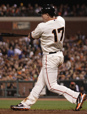 SAN FRANCISCO - SEPTEMBER 16:  Aubrey Huff #17 of the San Francisco Giants hits a three run home run against the Los Angeles Dodgers in the third inning during a Major League Baseball game at AT&T Park on September 16, 2010 in San Francisco, California.