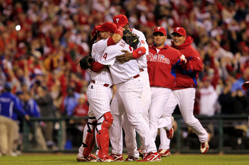 Roy Halladay #34 and Carlos Ruiz #51 of the Philadelphia Phillies celebrate Halladay's no-hitter and the win in Game 1 of the NLDS against the Cincinnati Reds at Citizens Bank Park on October 6, 2010 in Philadelphia, Pennsylvania. The Phillies defeated th