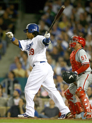 LOS ANGELES, CA - OCTOBER 15:  Manny Ramirez #99 of the Los Angeles Dodgers swings and hits a solo home run in the sixth inning against the Philadelphia Phillies in Game Five of the National League Championship Series during the 2008 MLB playoffs on Octob