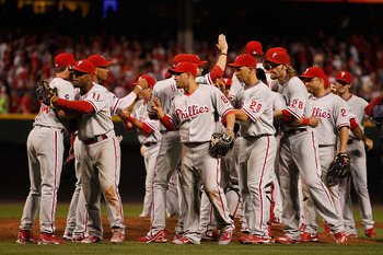 CINCINNATI - OCTOBER 10: Members of the Philadelphia Phillies including Jimmy Rollins #11, Shane Victorino #8, Raul Ibanez #29, Jayson Werth #28 and Placido Polanco #27 celebrate a three game sweep of the Cincinnati Reds following game 3 of the NLDS at Gr