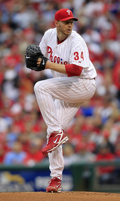 PHILADELPHIA - OCTOBER 06:  Roy Halladay #34 of the Philadelphia Phillies delivers in Game 1 of the NLDS against the Cincinnati Reds at Citizens Bank Park on October 6, 2010 in Philadelphia, Pennsylvania.  (Photo by Chris Trotman/Getty Images)