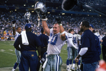 TEMPE, AZ - JANUARY 28:  Safety Bill Bates #40 of the Dallas Cowboys celebrates on the sidelines during Super Bowl XXX against the Pittsburgh Steelers at Sun Devil Stadium on January 28, 1996 in Tempe, Arizona.  The Cowboys won 27-17.  (Photo by George Ro