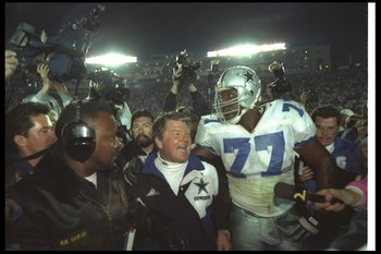 31 Jan 1993:  Dallas Cowboys head coach Jimmy Johnson celebrates with defensive lineman Jim Jeffcoat #77 after Super Bowl XXVII against the Buffalo Bills at the Rose Bowl in Pasadena, California.  The Cowboys won the game, 52-17. Mandatory Credit: Mike Po