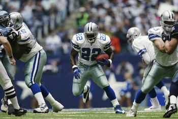 IRVING, TX - OCTOBER 27:   Running Back Emmitt Smith #22 of the Dallas Cowboys advances the ball during the NFL game against the Seattle Seahawks at Texas Stadium on October 27, 2002 in Irving, Texas. The Seahawks defeated the Cowboys 17-14. (Photo by Ron