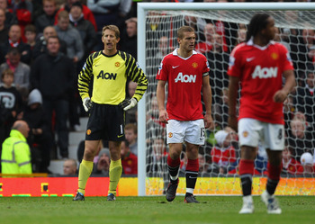 MANCHESTER, ENGLAND - OCTOBER 16:  Edwin Van Der Sar of Manchester United looks dejected after his mistake led to the equalizing goal during the Barclays Premier League match between Manchester United and West Bromwich Albion at Old Trafford on October 16