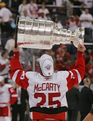 PITTSBURGH - JUNE 04: Darren McCarty #25 of the Detroit Red Wings celebrates with the Stanley Cup after defeating the Pittsburgh Penguins in game six of the 2008 NHL Stanley Cup Finals at Mellon Arena on June 4, 2008 in Pittsburgh. Pennsylvania. The Red W