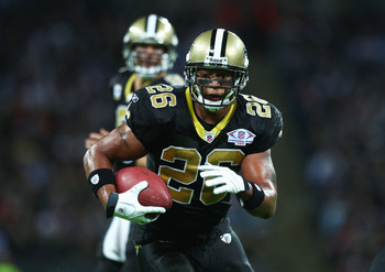 LONDON - OCTOBER 26: Deuce McAllisters of the New Orleans Saints runs with the ball during the Bridgestone International Series NFL match between San Diego Chargers and New Orleans Saints at Wembley Stadium on October 26, 2008 in London, England.  (Photo